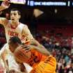 Oklahoma State's Markel Brown 922) drives against Texas Tech's Dejan Kravic during their NCAA college basketball game, Wednesday, Feb. 13, 2013, in Lubbock, Texas. (AP Photo/The Avalanche-Journal, Zach Long) ALL LOCAL TV OUT