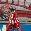 Olympiakos' Giannis Maniatis celebrates with teammate Kostas Manolas after scoring against Arsenal during a group B Champions League soccer match in the port of Piraeus, near Athens, Tuesday, Dec. 4, 2012. (AP Photo/Thanassis Stavrakis)