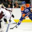 Edmonton Oilers' Sam Gagner scores on Colorado Avalanche goalie Semyon Varlamov during the first period of an NHL hockey game in Edmonton, Alberta, on Friday, Dec. 9, 2011. (AP Photo/The Canadian Press, John Ulan)