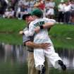 GOLFER, Scott Verplank celebrates his hole-in-one on the 9th green with his son, Scottie, during the Par 3 Contest at the Augusta National Golf Club in Augusta, Ga., Wednesday, April 4, 2001, as part of the Masters festivities.  First round Masters play begins Thursday.   (AP Photo/Doug Mills)