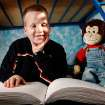 BLIND / BLINDNESS: Daniel Brookshire, a Tulsa eighth-grader, sits on his bed with one of the Braille volumes of the Bible in his family's home  on Thursday, Jan. 7, 2010. Photo by Jim Beckel, The Oklahoman ORG XMIT: KOD