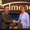 Former Mayor Dan O'Neil and new Mayor Patrice Douglas shake hands during a ceremony at council chambers in Edmond on Monday, May 4, 2009. Photo by John Clanton, The Oklahoman