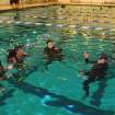 Instructor candidates Gregg Starkel, Patrick Wright, and Connie Cooler listen to instructions from Examiner Gary Newman in the pool at the Cleveland County Family YMCA in Norman during the PADI Instructor Examination.  Community Photo By:  Lea Ann Hughes  Submitted By:  alan, norman