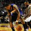 Phoenix Suns point guard Eric Bledsoe, left, loses control of the ball as Portland Trail Blazers point guard Mo Williams reaches in during the first quarter of an NBA basketball game on Wednesday, Nov. 13, 2013, in Portland, Ore. (AP Photo/Steve Dykes)