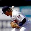 Minnesota Twins shortstop Brian Dozier loses the ball on a fielding error as Pittsburgh Pirates' Jeff Larish reaches first first base  in the ninth inning of a spring training exhibition baseball game, Sunday March 10, 2013, in Fort Myers, Fla. (AP Photo/David Goldman)