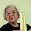 FILE - Stephanie Kwolek   poses for a photo holding with a spool of Kevlar, in this June 20 2007 file photo taken in Brandywine Hundred, Del. Her friend, Rita Vasta, told The Associated Press that Stephanie Kwolek died Wednesday June 18, 2014 in a Wilmington hospital. She was 90.  (AP Photo/The News Journal, Jennifer Corbett)