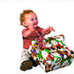 CHRISTMAS PRESENTS / GIFT / KIDS / CHILD / CHILDREN: Gabe McDonnell, 2, opens a present in OPUBCO studio Friday, Nov. 14, 2008. PHOTO BY DOUG HOKE THE OKLAHOMAN. ORG XMIT: KOD