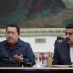 In this photo released by Miraflores Press Office, Venezuela's President Hugo Chavez , left, speaks beside his Vice-President Nicolas during a televised speech form his office at Miraflores Presidential palace in Caracas, Venezuela, Saturday, Dec. 8, 2012. Chavez announced Saturday night that his cancer has returned and that he will undergo another surgery in Cuba. Chavez, who won re-election on Oct. 7, also said for the first time that if his health were to worsen, his successor would be Vice President Nicolas Maduro.(AP Photo/Miraflores Press Office, Marcelo Garcia)