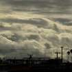 Storm clouds gather over Oakland, Calif., on Monday, Nov. 9, 2015. A storm crossed the region Monday morning bringing rain, thunder and lightning to the drought-parched region. (AP Photo/Noah Berger)