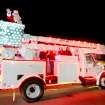 Santa Claus rides in a bucket truck during the Edmond Electric Parade of Lights in Edmond, Oklahoma December 3, 2009. Photo by Steve Gooch, The Oklahoman