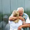 DIGNITY MEMORIAL WALL / VIETNAM VETERANS: Veteran Paul Jones, of Guthrie, hugs his daughter Allison Robinson, after he looks up names on the Dignity Memorial Vietnam Wall at Reaves Park in Norman on Sunday, July 4, 2010. Photo by John Clanton, The Oklahoman ORG XMIT: KOD