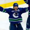 Vancouver Canucks' Kevin Bieksa celebrates his winning goal against the Phoenix Coyotes during the third period of an NHL hockey game in Vancouver, British Columbia, on Sunday, Jan. 26, 2014. (AP Photo/The Canadian Press, Darryl Dyck)