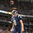 St. Louis Rams quarterback Sam Bradford flips the ball in the air after scoring on a two-point conversion to bring the Rams within a field goal of tying the game during the fourth quarter of an NFL football game, Sunday, Sept. 8, 2013 in St. Louis. (AP Photo/St. Louis Post-Dispatch, Chris Lee)  EDWARDSVILLE INTELLIGENCER OUT; THE ALTON TELEGRAPH OUT  ORG XMIT: MOSTP205