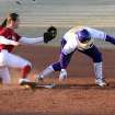 LSU's Ashley Langoni gets back to the base ahead of OU's Jessica Vest during the University of Oklahoma - Louisiana State University game at