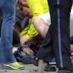 In this photo provided by The Daily Free Press and Kenshin Okubo, people help an injured person after an explosion at the 2013 Boston Marathon in Boston, Monday, April 15, 2013. Two explosions shattered the euphoria of the Boston Marathon finish line on Monday, sending authorities out on the course to carry off the injured while the stragglers were rerouted away from the smoking site of the blasts. (AP Photo/The Daily Free Press, Kenshin Okubo) MANDATORY CREDIT ORG XMIT: NYKS106