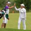 Inbee Park, right, celebrates her eagle on the 10th hole with her caddy during the final round of the Manulife Financial LPGA Classic golf tournament in Waterloo, Ontario, Sunday, July 14, 2013. (AP Photo/The Canadian Press, Geoff Robins)