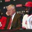 Cincinnati Reds Brandon Phillips laughs with with Reds owner Bob Castellini, center and manager Dusty Baker, left, after announcing his signing of a six year contract at Great American Ballpark in Cincinnati Tuesday April 10, 2012. Phillips signed a six-year, $72.5 million contract through the 2017 season. (AP Photo/Tom Uhlman)