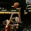 Iowa center Morgan Johnson (12) puts up ascot against Iowa State  forward Hallie Christofferson (5) during the first half an NCAA college basketball game Thursday, Dec. 6, 2012 at Carver-Hawkeye Arena in Iowa City, Iowa.  (AP Photo/The Gazette,Brian Ray)