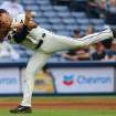 Atlanta Braves Andrelton Simmons makes a difficult play on a ground ball hit by Phillies Marlon Byrd who was able to reach first for a single  during the seventh inning of a baseball game on Sunday, July 20, 2014, in Atlanta.  (AP Photo/Atlanta Journal-Constitution, Curtis Compton)