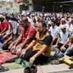 Followers of Shiite cleric Muqtada al-Sadr attend open-air Friday prayers in the Shiite stronghold of Sadr City, Baghdad, Iraq, Friday, July 4, 2014. (AP Photo/Karim Kadim)
