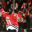 Chicago Blackhawks right wing Marian Hossa celebrates his second goal of the game as the Blackhawks defeated the Minnesota Wild 5-1 in Game 5 of an NHL hockey Stanley Cup first-round playoff series in Chicago, Thursday, May 9, 2013. (AP Photo/Daily Herald,  George LeClaire)