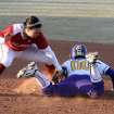 LSU's Ashley Langoni slides in safe under the tag of OU's Hannah Bowen during the University of Oklahoma - Louisiana State University game at