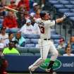 Atlanta Braves Chris Johnson hits a two-run homer  against the Philadelphia  Phillies during the second inning of a baseball game on Sunday, July 20, 2014, in Atlanta.  (AP Photo/Atlanta Journal-Constitution, Curtis Compton)