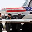The remains of U.S. Army SSgt. Travis Tompkins arrived in a flag-draped casket on a small jet that arrived at Henry Post Army Airfield  on Ft. Sill around 12 :45 Wednesday afternoon, March 23, 2011.  He died March 16 of wounds sustained in an attack the previous day when enemy forces attacked his unit in Afghanistan with a rocket-propelled grenade.  His funeral is scheduled for Friday.   Photo by Jim Beckel, The Oklahoman