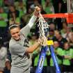 Notre Dame guard Kayla McBride holds a piece of the net after their NCAA women's college basketball tournament regional final game at the Purcell Pavilion in South Bend, Ind Monday March 31, 2014. Notre Dame beat Baylor,  88-69. (AP Photo/Joe Raymond)