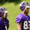 Minnesota Vikings wide receivers Jarius Wright, left, and Greg Childs take a rest during rookie mini-camp, Friday, May 4, 2012, in Eden Prairie, Minn. The two players met as little kids, were high school teammates who went on to play football at the University of Arkansas together. Now they are both NFL fourth-round draft picks chosen by the Vikings. (AP Photo/Genevieve Ross)