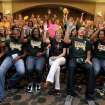 Baylor head basketball coach Kim Mulkey, center, and the team give the