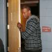 Brooklyn Nets center Jason Collins leaves a dressing room where he met with the parents of Matthew Shepard, who was killed as part of an anti-gay hate crime in Laramie, Wyo., in 1998, after the Nets' 112-89 victory over the Denver Nuggets in an NBA basketball game in Denver on Thursday, Feb. 27, 2014. (AP Photo/David Zalubowski)