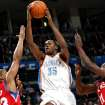 OKLAHOMA CITY THUNDER / PHILADELPHIA 76ERS: Oklahoma City's Kevin Durant puts up a shot in front of Philadelphia's Willie Green (left) and Jrue Holiday during the first half of their NBA basketball game at the Ford Center in Oklahoma City on Wednesday, Dec. 2, 2009. By John Clanton, The Oklahoman ORG XMIT: KOD