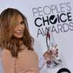 Naya Rivera arrives with the award for Favorite TV Gal Pal at the 40th annual People's Choice Awards at Nokia Theatre L.A. Live on Wednesday, Jan. 8, 2014, in Los Angeles. (Photo by John Shearer/Invision/AP)