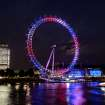 The London Eye observation wheel on the banks of the river Thames celebrates the birth of the Duke and Duchess of Cambridge's son by lighting up in the national colors of red, white and blue,  Monday July 22, 2013. (AP Photo/ Doug Peters, PA) UNITED KINGDOM OUT - NO SALES - NO ARCHIVES