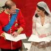 Britain's Prince William and his bride Kate Middleton during their wedding service at Westminster Abbey, London, Friday April 29, 2011. (AP Photo/Andrew Milligan, Pool) ORG XMIT: RWBJ110