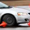 Orange cones bounce off this car as the driver maneuvers their way through a figure-eight shaped course lined with pylons. Eight high school students participated in a collision avoidance training course put on by the Oklahoma City Police Department this weekend.   The students, 16 to 19, received four hours of classroom instruction before taking to the training course for eight hours Saturday, Feb. 18, 2012,  at the Oklahoma County Sheriff's training facility in northeast Oklahoma County.  This the first time the course has been offered in Oklahoma, said Paul Burris, director and founder of the Florida-based nonprofit the National Traffic and Safety Academy.     Photo by Jim Beckel, The Oklahoman