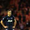 Manchester United's captain Nemanja Vidic stands dejected after being defeated by Sunderland at the end of their English League Cup semifinal first leg soccer match at the Stadium of Light, Sunderland, England, Tuesday, Jan. 7, 2014. (AP Photo/Scott Heppell)