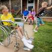 CHILD / CHILDREN / KIDS: Anthony Middleton, 11, left, makes bubbles as his brother Jackie Middleton, 9, right, chases the bubbles while parents Michael Snider and Jennifer Snider sit on the porch with DeJay Middleton, 6. at their home in Cordell, Okla., Thursday, May 6, 2010. Anthony, Jackie and DeJay have ALD (adrenoleukodystrophy). Photo by Nate Billings, The Oklahoman ORG XMIT: KOD