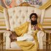 In this film image released by Paramount Pictures, Sacha Baron Cohen, portrays Admiral General Aladeen in a scene from
