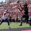 Texas Tech's Darrin Moore makes a touchdown catch in front of Kansas' Greg Brown during their NCAA college football game in Lubbock, Texas, Saturday, Nov. 10, 2012. (AP Photo/Lubbock Avalanche-Journal, Zach Long) LOCAL TV OUT