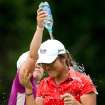 Lydia Ko, of New Zealand, is sprayed with water by Jiyai Shin, of South Korea, after winning the LPGA Tour's Canadian Women's Open golf tournament, Sunday, Aug. 26, 2012, at the Vancouver Golf Club in Coquitlam, British Columbia. (AP Photo/The Canadian Press, Darryl Dyck)
