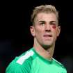 Manchester City's Joe Hart with a cut below his eye, which he injured in the match  looks on during the English  Premier League match against Crystal Palace  at the Etihad Stadium, Manchester England Saturday Dec. 28, 2013. City won the match 1-0.(AP Photo/Dave Thompson/PA)  UNITED KINGDOM OUT