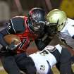 WM #11 WR Deshawn Lookout fights for more yards as he is hit by BA #7 Gysai Akem after a long catch and run during the high school football game between Broken Arrow and Westmoore at Moore stadium Friday , November 8, 2013. Photo by Doug Hoke, The Oklahoman