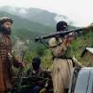 FILE - In this file photo taken on Aug. 5, 2012, Pakistani Taliban patrol in their stronghold of Shawal in Pakistani tribal region of South Waziristan. The Pakistani army said it has launched a