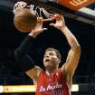 Los Angeles Clippers' Blake Griffin slams down a basket against the Phoenix Suns during the first half of an NBA basketball game Sunday, Dec. 23, 2012, in Phoenix. (AP Photo/Ralph Freso)
