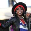 FILE - This April 15, 2011 file photo shows singer Lauryn Hill performing during the 12th Coachella Valley Music and Arts Festival in Indio, Calif. Hill faces sentencing in New Jersey on tax evasion charges. Hill pleaded guilty last June to not paying federal taxes on $1.8 million earned from 2005-2007. She faces a maximum one-year jail term on each of the three counts when she's sentenced Monday, April 22, 2013.  (AP Photo/Spencer Weiner, file)