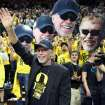 Nike founder and Oregon donor Phil Knight acknowledge the crowd on Uncle Phil Appreciation Night at Matthew Knight Arena during Oregon's basketball game against Southern California in an NCAA college basketball game in Eugene, Ore. on Saturday, Feb. 1, 2014. (AP Photo/Chris Pietsch)