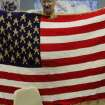 Eric Fowler, member of the Veteran's club, holds up a gold star quilted American flag as apart of the Afghan project at the James Crabtree Correction Center.  Photo by Darryl Golden, The Oklahoman