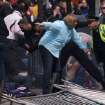 In this photo provided by The Daily Free Press and Kenshin Okubo, people react to an explosion at the 2013 Boston Marathon in Boston, Monday, April 15, 2013. Two explosions shattered the euphoria of the Boston Marathon finish line on Monday, sending authorities out on the course to carry off the injured while the stragglers were rerouted away from the smoking site of the blasts. (AP Photo/The Daily Free Press, Kenshin Okubo) MANDATORY CREDIT ORG XMIT: NYKS103